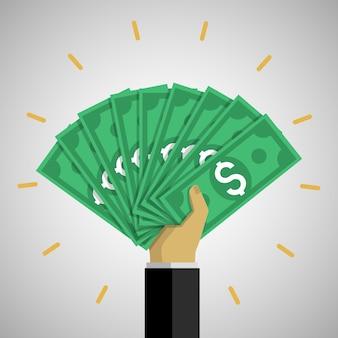 Hand, die viele dollarnoten hält