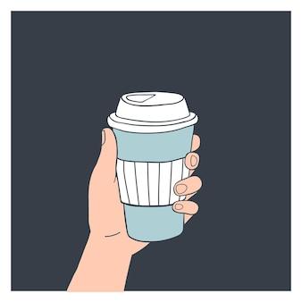Hand, die wiederverwendbare kaffeetasse hält.