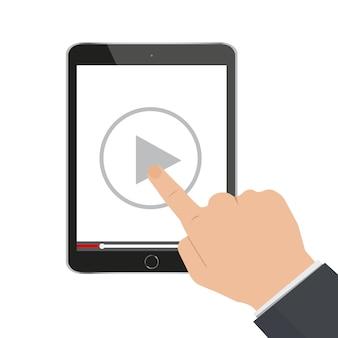 Hand, die zeigt, um knopf auf einem tablet-computer zu spielen, um videoanleitung zu sehen.