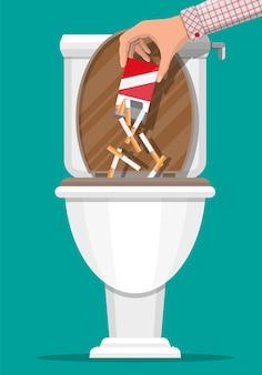 Hand, die zigaretten in toilette legt
