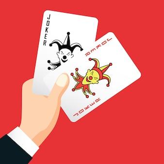 Hand, die zwei joker, spielkartenkonzept des pokers hält
