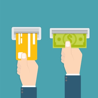 Hand führt eine kreditkarte in den geldautomaten ein und hand nimmt das geld vom geldautomaten