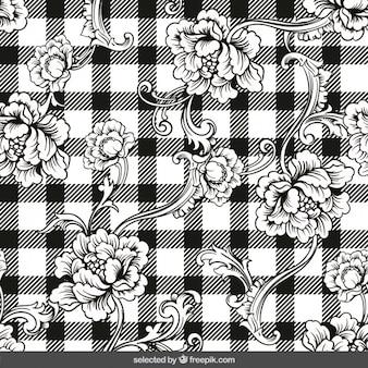 Hand gezeichnet floralen ornamenten auf ginghamhintergrund