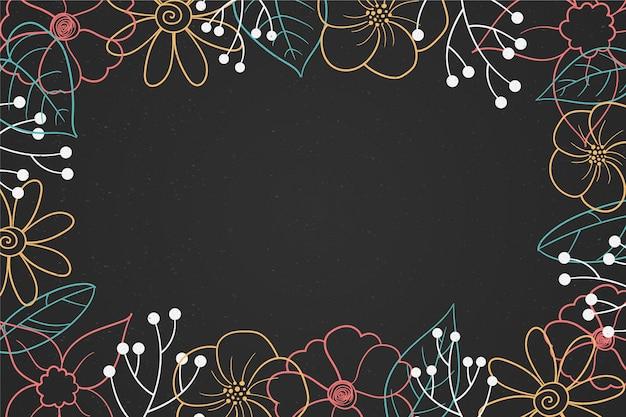 Hand gezeichnete blumen auf tafelhintergrund