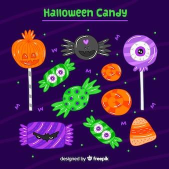 Hand gezeichnete bunte halloween-süßigkeitsammlung