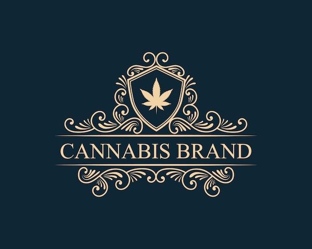 Hand gezeichnete cannabis vintage luxus stil logo vorlage mit goldener farbe