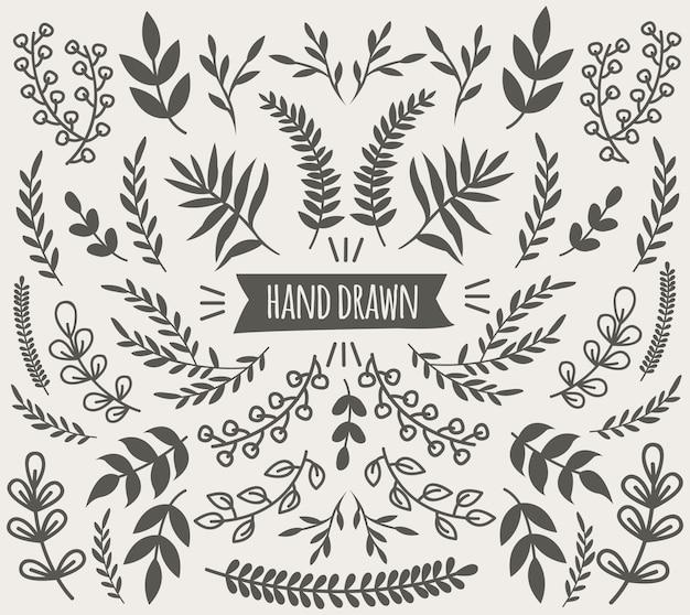 Hand gezeichnete dekorative blumenelementensammlung mit blumenzweigen und -blättern lokalisiert