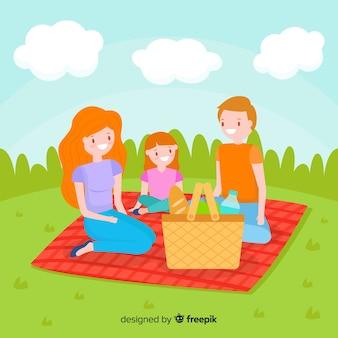 Hand gezeichnete familie, die ein picknick hat