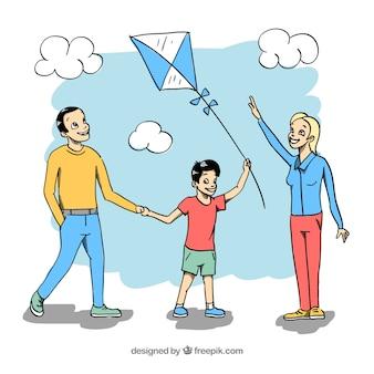 Hand gezeichnete familie, die mit drachen spielt