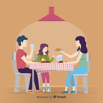Hand gezeichnete familie, die um tabelle sitzt