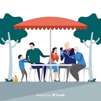 Hand gezeichnete familie, die zusammen draußen isst