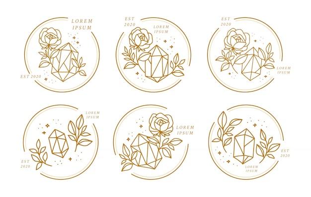 Hand gezeichnete goldkristall- und rosenblumenlogo-elementkollektion