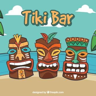 Hand gezeichnete hawaiianische masken am strand