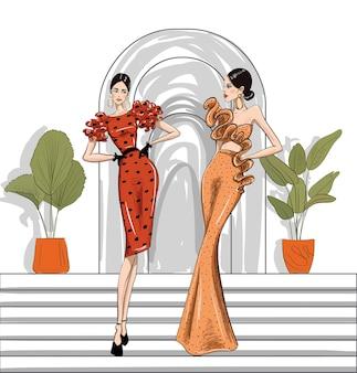 Hand gezeichnete modefrauen in couture-kleidern