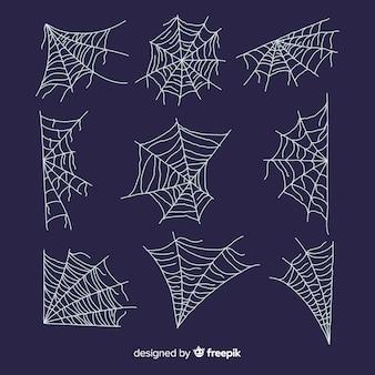 Hand gezeichnete spinnennetzsammlung auf blauem hintergrund