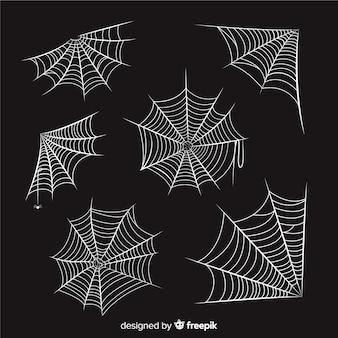 Hand gezeichnete spinnennetzsammlung auf schwarzem hintergrund