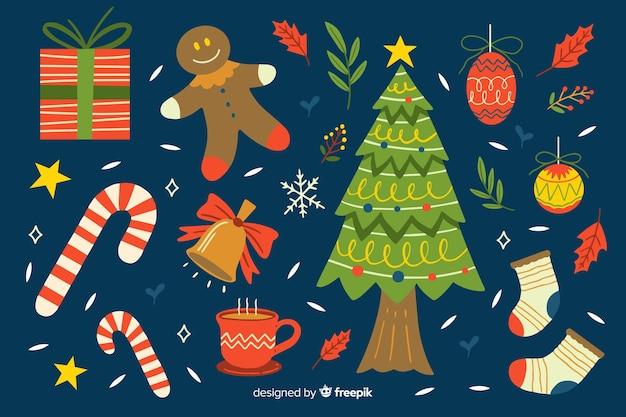 Hand gezeichnete weihnachtselementsammlung auf blauem hintergrund