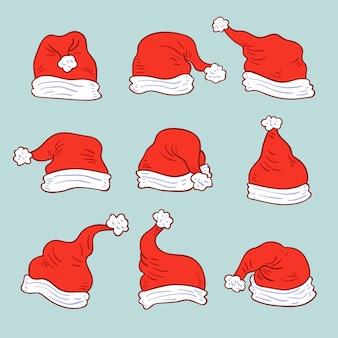 Hand gezeichnete weihnachtsmannhüte gesetzt