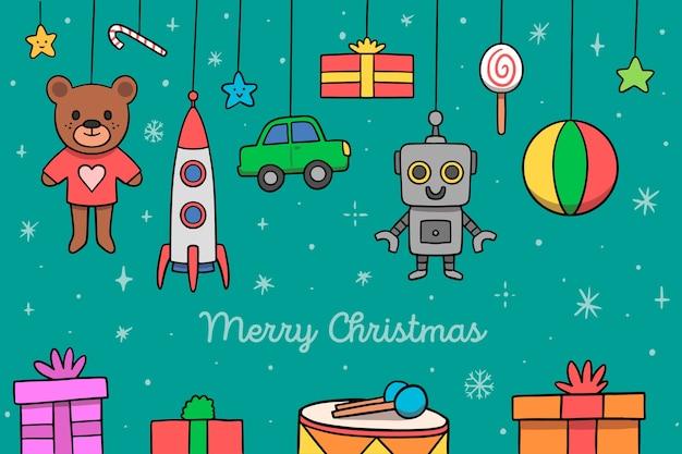 Hand gezeichnete zusammenstellung von weihnachtsspielwaren