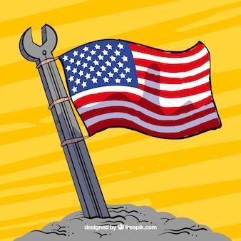 Hand gezeichneten schraubenschlüssel mit der amerikanischen flagge winken