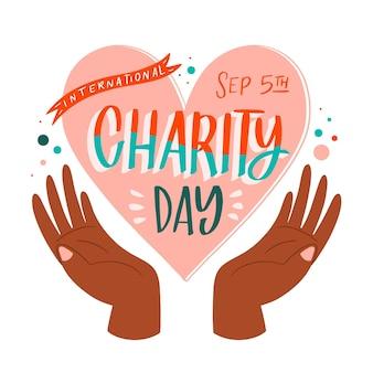 Hand gezeichneter internationaler tag der wohltätigkeitshintergrund mit herz