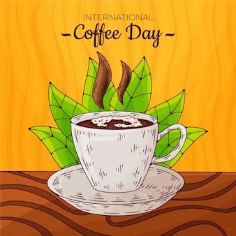Hand gezeichneter internationaler tag des kaffees mit tasse