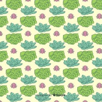 Hand gezeichneter kaktusmusterhintergrund