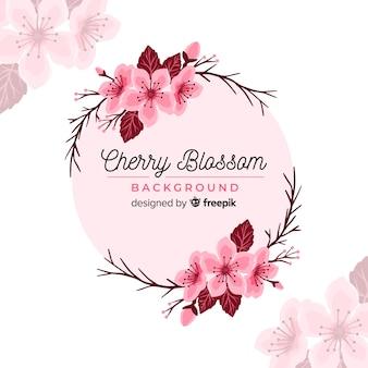 Hand gezeichneter kirschblüten-kranzhintergrund