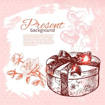 Hand gezeichneter vorhandener hintergrund der weinlese mit geschenkbox. vektorillustration mit spritzendesign