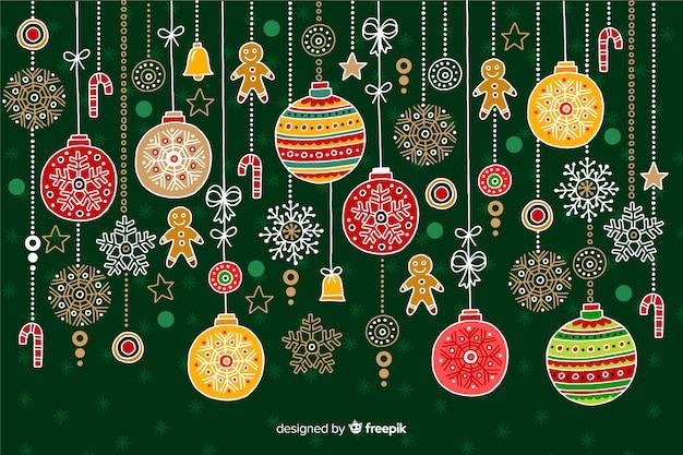 Hand gezeichneter weihnachtshintergrund mit dekoration