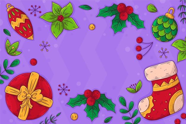 Hand gezeichneter weihnachtshintergrund mit geschenk und socke
