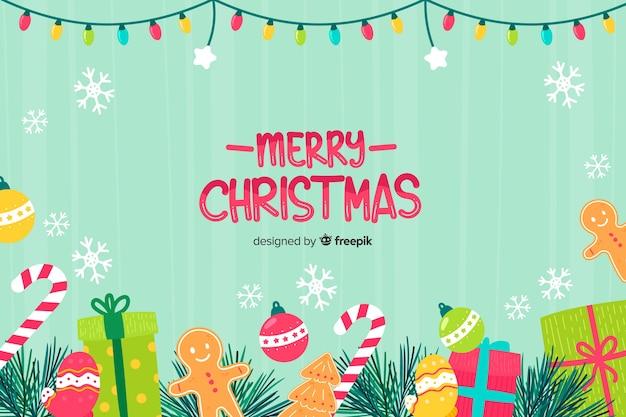 Hand gezeichneter weihnachtshintergrund mit weihnachtselementen