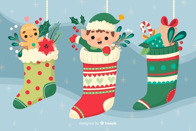 Hand gezeichneter weihnachtshintergrund mit weihnachtssocken