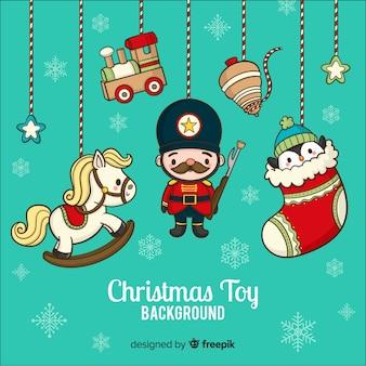 Hand gezeichneter weihnachtsspielzeughintergrund
