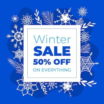 Hand gezeichneter winterverkauf mit schneeflocken