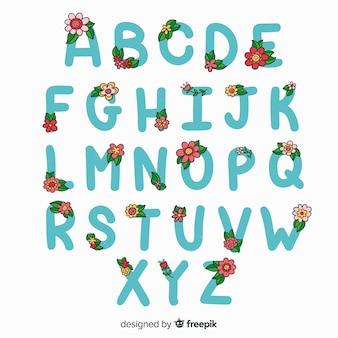 Hand gezeichnetes alphabet mit blumen