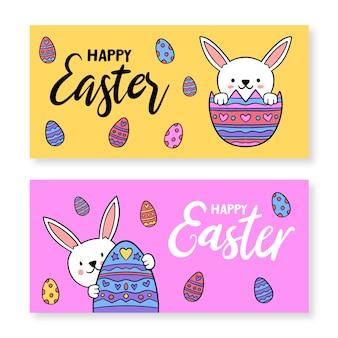 Hand gezeichnetes banner für ostern mit eiern und kaninchen
