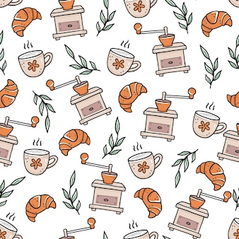 Hand gezeichnetes nahtloses muster des gekritzelartes von croissants und von den tassen kaffee nahe weinlesemühlen und -blättern