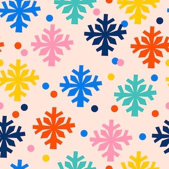 Hand gezeichnetes nahtloses muster mit konfetti und schneeflocken ideal für geschenkpapier textil weihnachten und neujahr hintergrund
