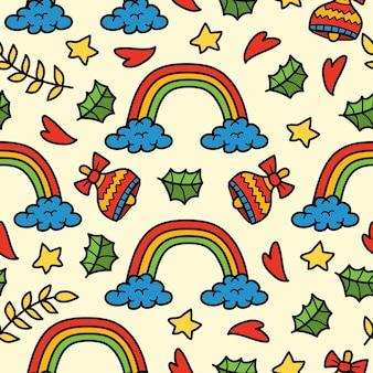 Hand gezeichnetes nahtloses musterdesign der regenbogengekritzelkarikatur
