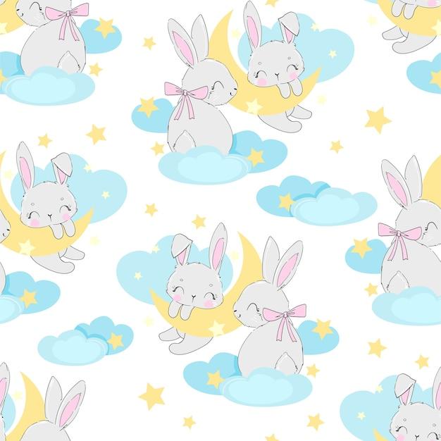 Hand gezeichnetes niedliches kaninchen auf dem mondmuster nahtlos. druckdesign für babypyjamas, textilien ..