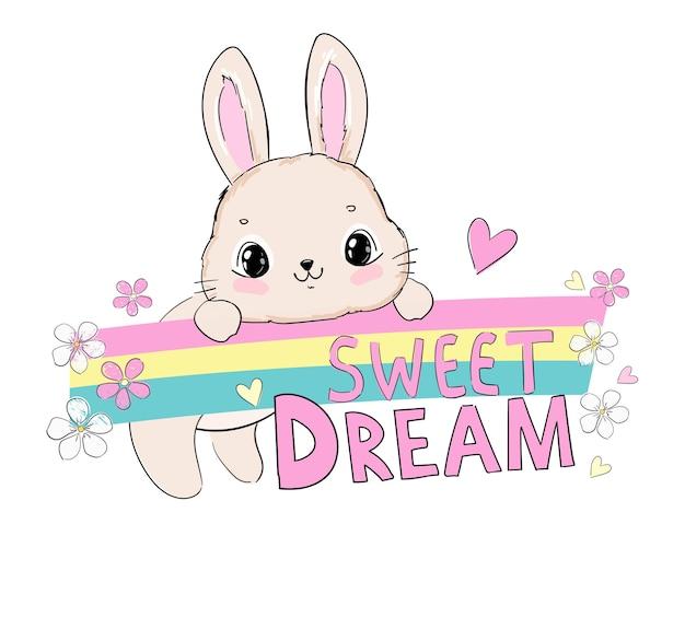 Hand gezeichnetes niedliches kaninchen und regenbogen mit blumen und herzen und handgeschriebener satz süßer traum lokalisiert