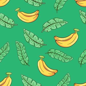Hand gezeichnetes schönes nahtloses vektorblumen-sommermuster mit bananenblättern und bananen