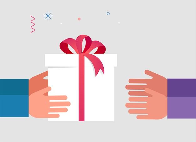 Hand gibt eine geöffnete weiße geschenkbox mit rotem band