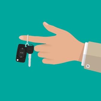 Hand hält autoschlüssel mit alarm und kette