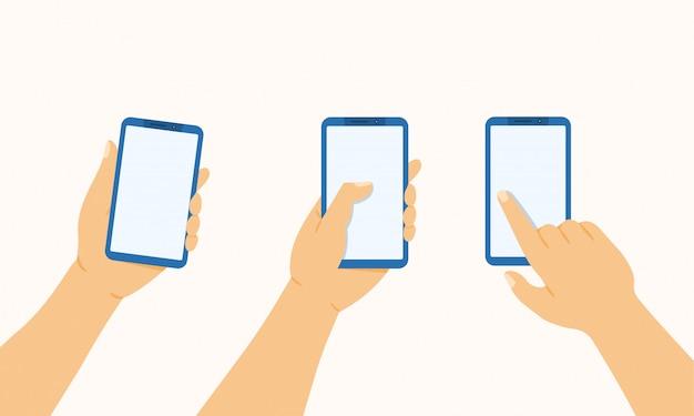 Hand hält das telefon, drückt und zeigt mit einem finger auf ein mobiltelefon