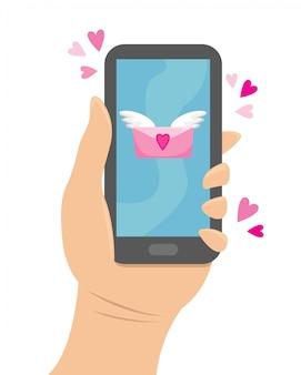 Hand hält das telefon, zu dem eine liebesbotschaft kam.