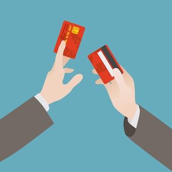 Hand hält die kreditkarte