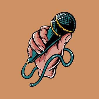 Hand hält ein mikrofon
