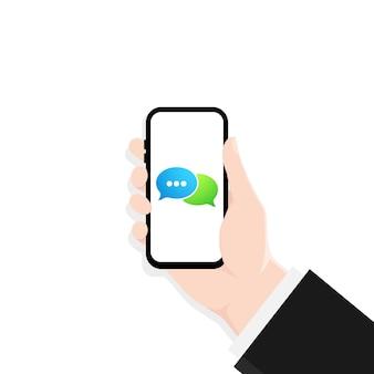 Hand hält ein mobiltelefon auf dem bildschirmsymbol